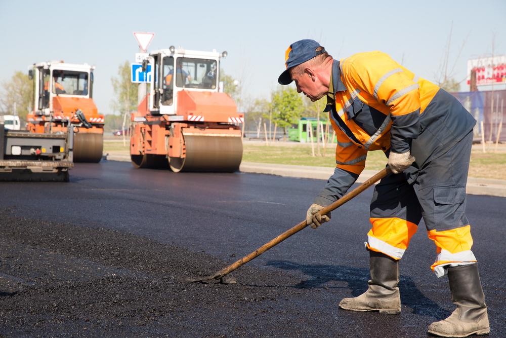 construction-worker-during-asphalting-road-works